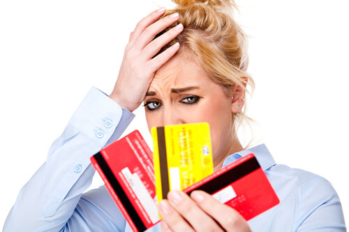 Stressed out woman with 3 credit cards