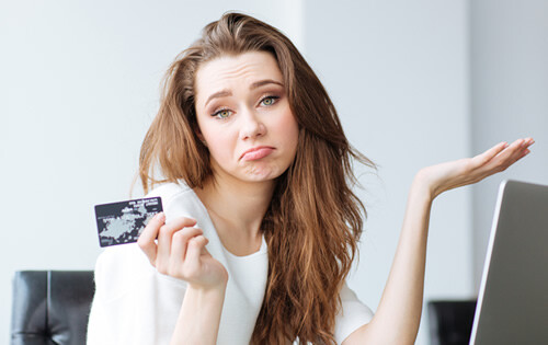 Woman who seams dis-concerned about a balance transfer credit card