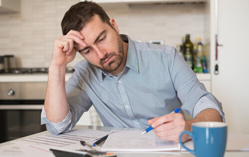 Man Stressed - Balance Transfer over Personal Loan for Debts