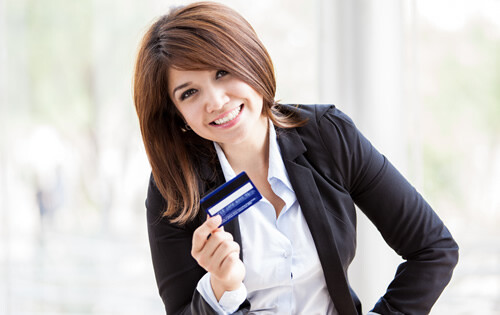 Happy and successful woman with a credit card