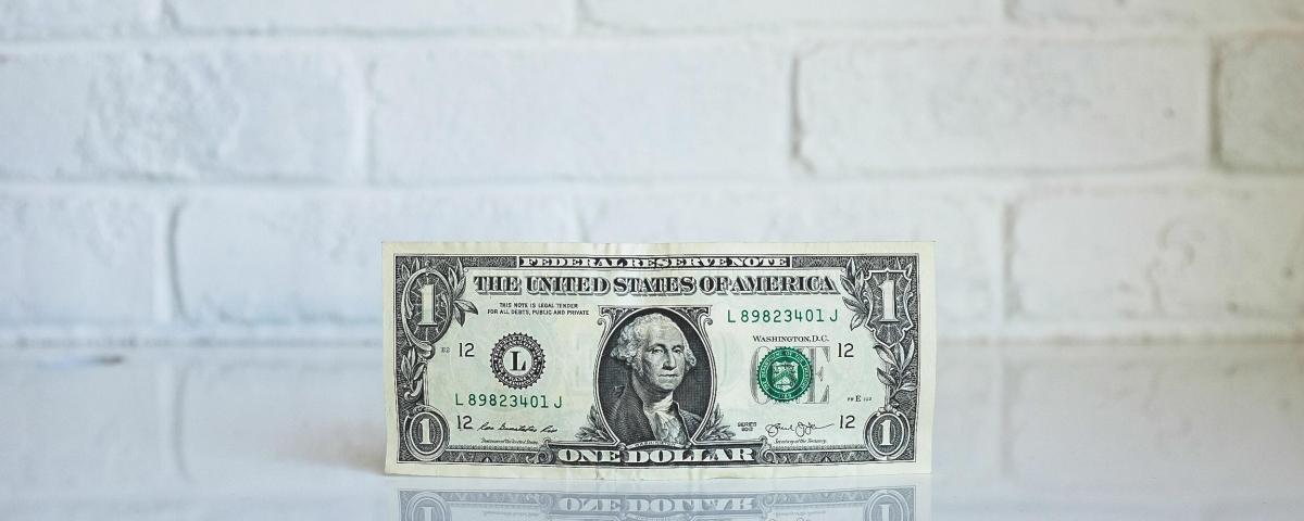 1 Dollar Bill on Shiny Table