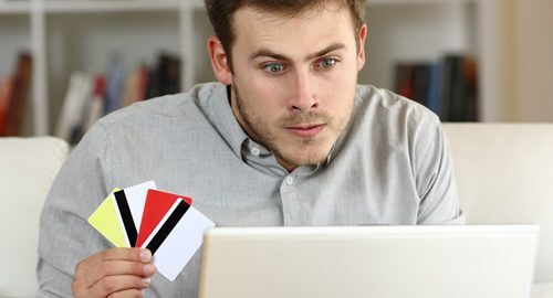 Upset man with 4 credit cards