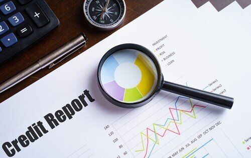 Magnifying glass on a credit report