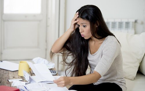 Stressed out woman with a lot of bills