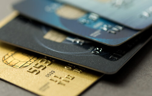 4 credit cards on top of each other