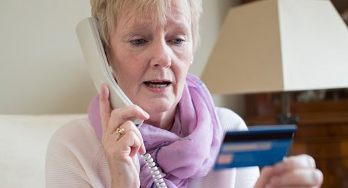 Woman with a credit card on the phone